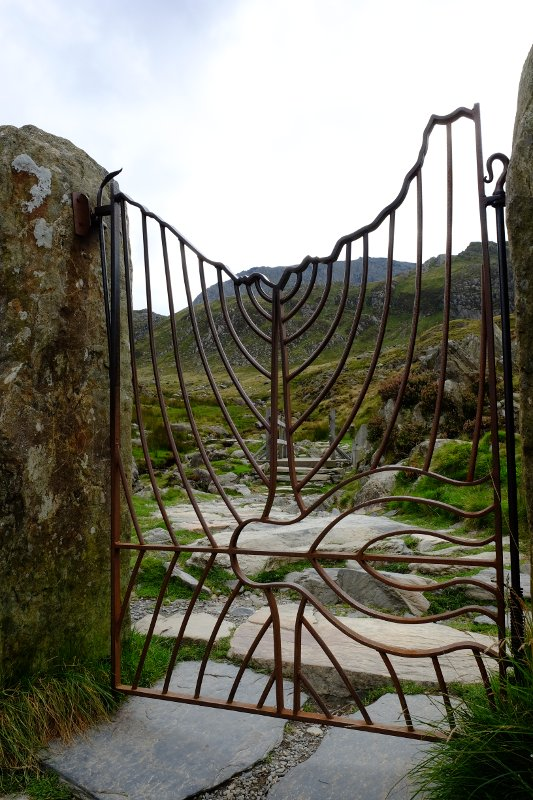 The gate near the start of the path.