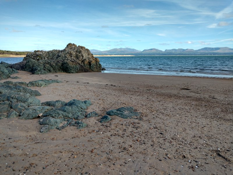 Looking back along the beach towards the mountains on the mainland.