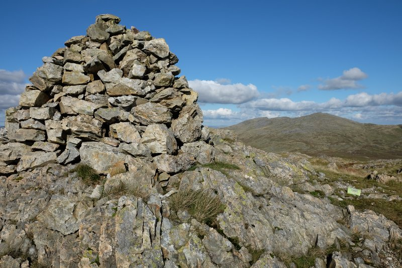 Glasgwm summit cairn and view to Aran Fawddwy.